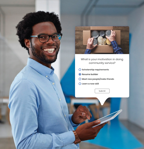 man smiling while using tablet to create an email with constant contact