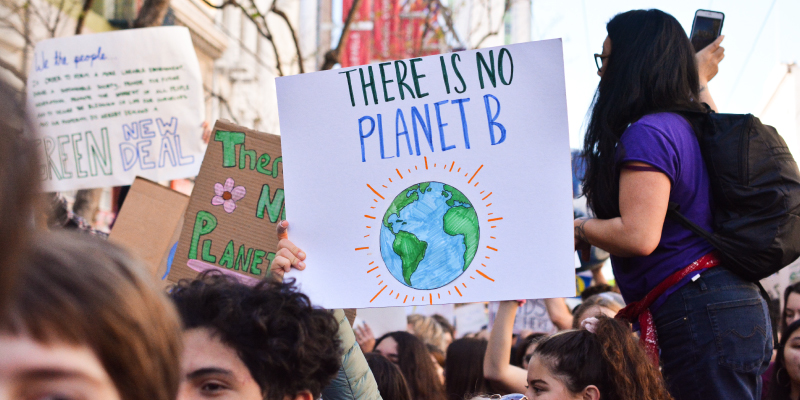 person holding planet sign