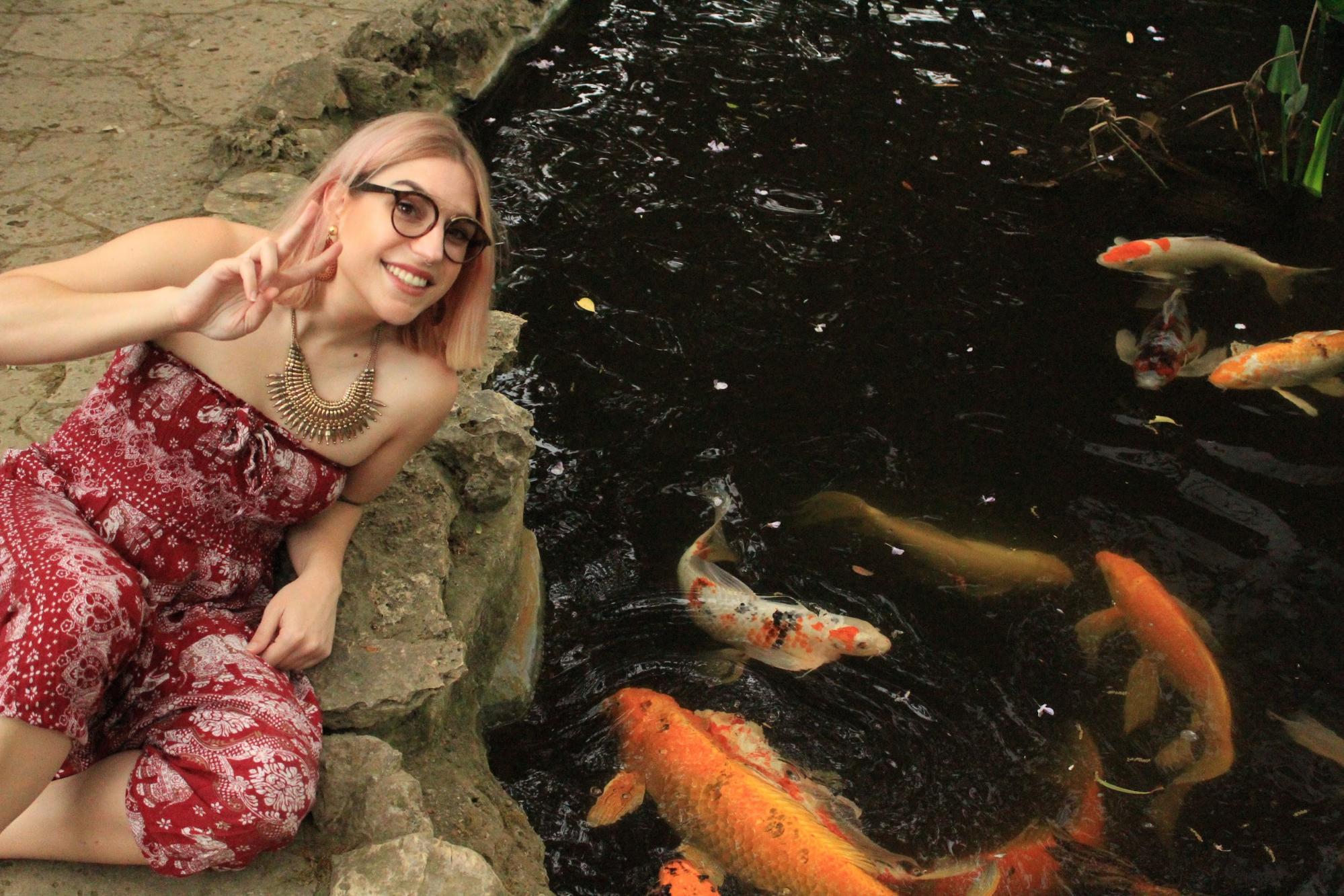 Laura next to koi pond